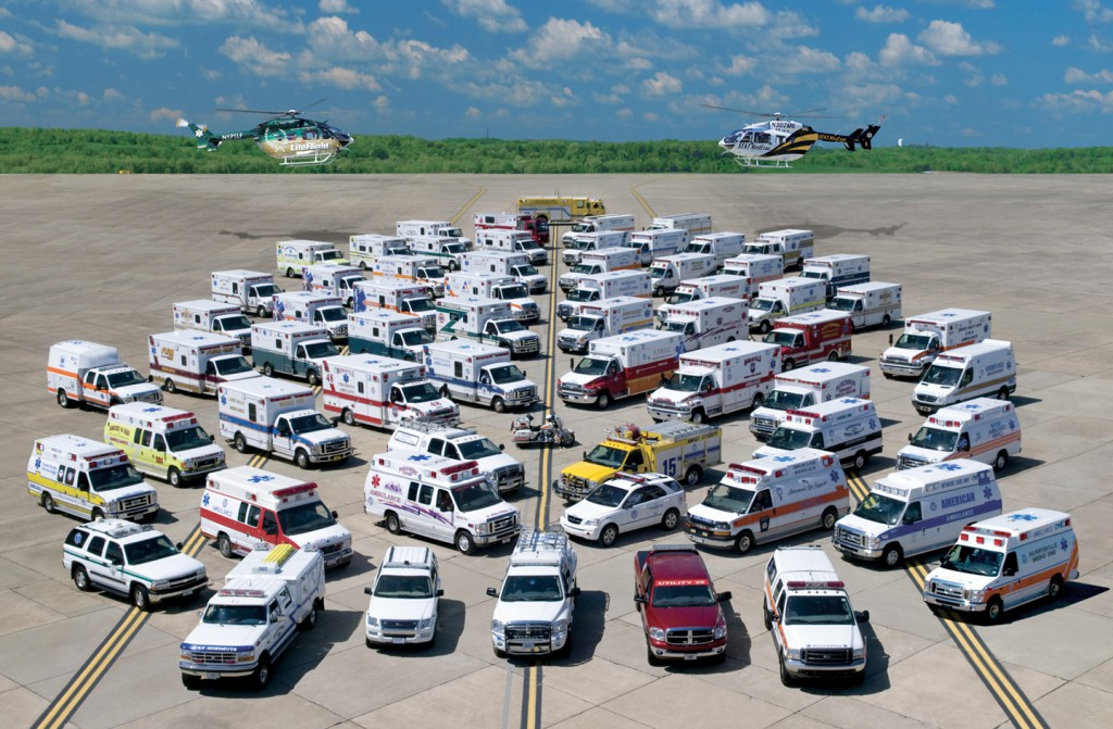 Emergency Medical Services vehicles lined up in an airfield